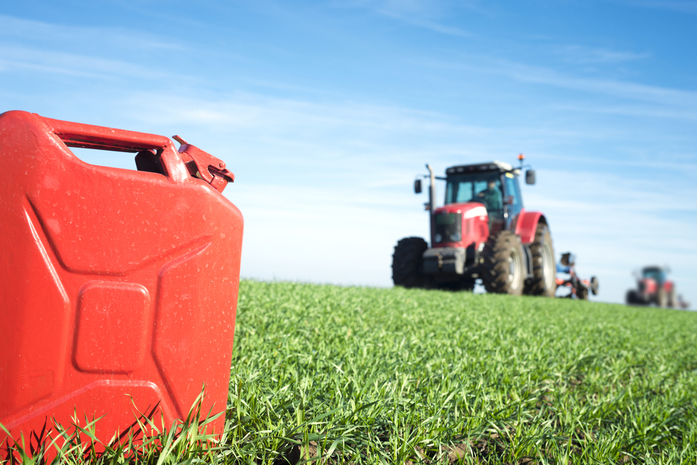 Fuel,And,Agriculture,Machines.,Gas,Can,And,Tractor,In,The